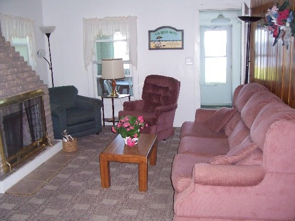 Beach House cottage sitting room and fireplace